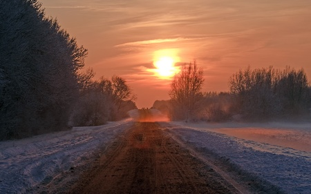 Snowy road at sunset, Holland, Europe photo