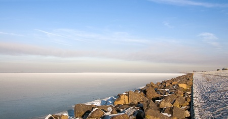 ice dam: Water and ice along a dam in winter, Holland, Europe Stock Photo