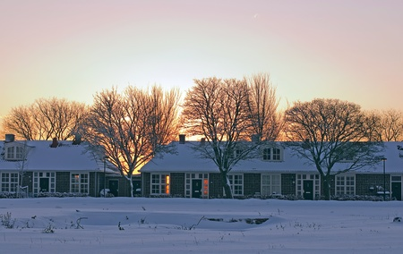 lelystad: Houses at sunrise in winter