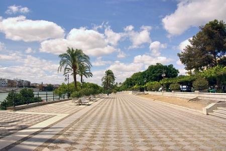 Boulevard along a river, Seville, Spain Stock Photo