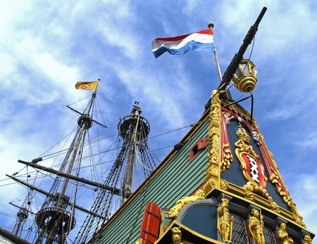 tall ship: Flags waving above an ancient tall ship
