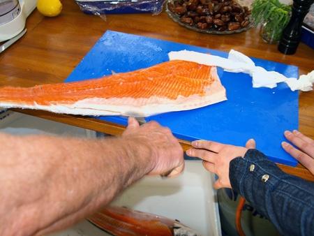 salmonidae: Preparing a salmon for dinner, Holland, Europe