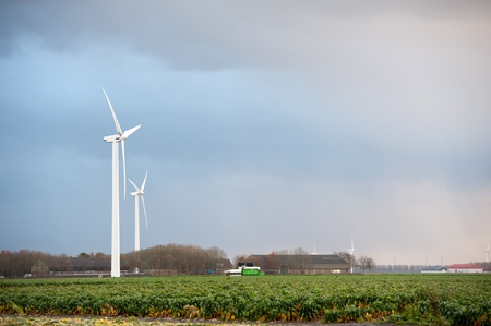 Wind turbines under grey clouds, Holland, Europe photo