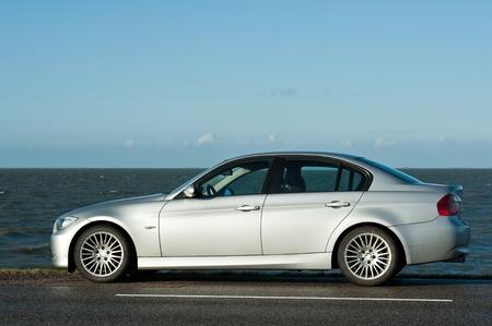 Car parked along a lake, Holland, Europe