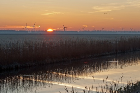 almere: Sunrise in winter over a canal