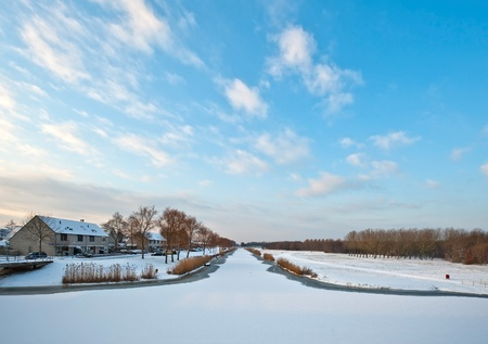 residential area: Frozen canal in a residential area