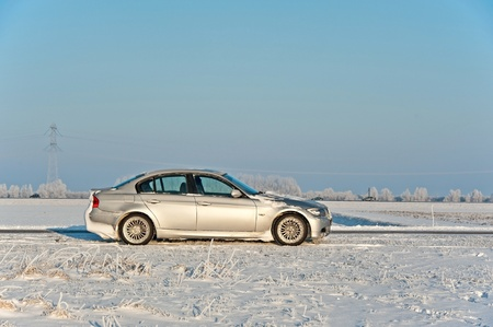 Car parked in the snow in winter Stock Photo