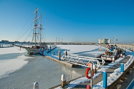 Tall ship in a frozen harbor in winter Stock Photo - 12423683