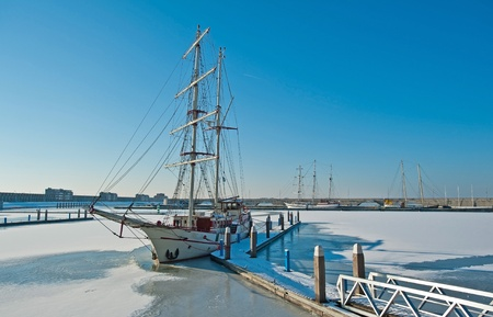 Tall ship in a frozen harbor in winter Stock Photo - 12423676