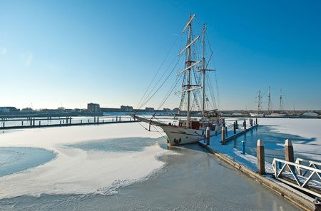 Tall ship in a frozen harbor in winter Stock Photo - 12423680