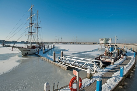 Tall ship in a frozen harbor in winter Stock Photo - 12423681