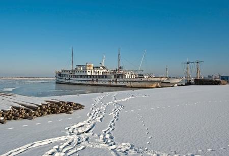 Rusty steamer in a frozen lake in winter Stock Photo - 12423648