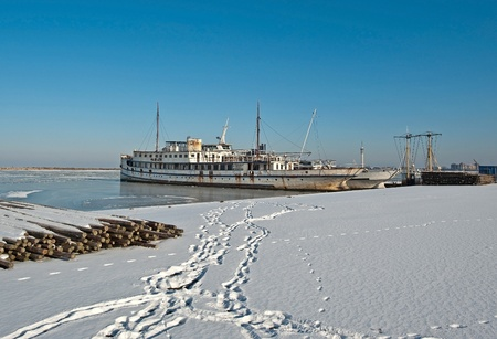Rusty steamer in a frozen lake in winter Stock Photo - 12423648