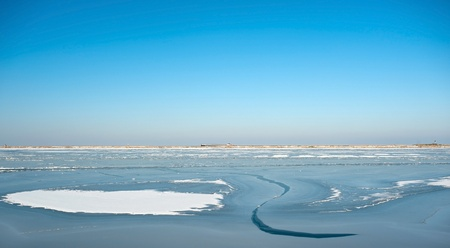 ice dam: Frozen lake under a blue sky in winter Stock Photo