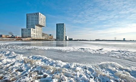 Apartments along a frozen lake in winter Stock Photo - 12423755