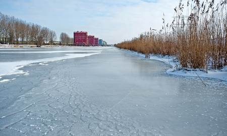 Apartments along a frozen canal in winter Stock Photo - 12423758