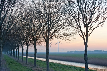 Sunrise and wind energy in winter photo