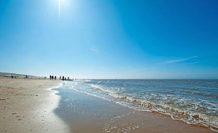 People walking on the beach in spring