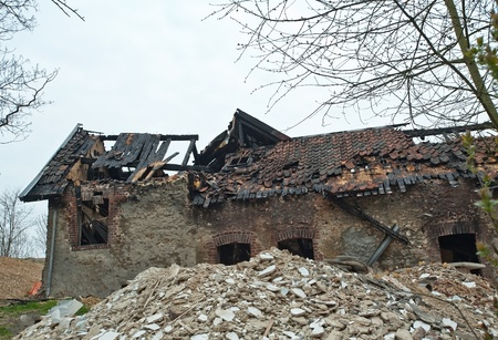 collapsed: Burnt and collapsed house Stock Photo