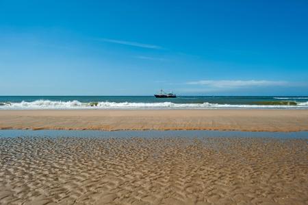 Trawler fishing at sea under a blue sky photo