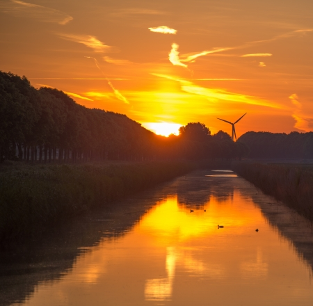 Dawn over a canal in spring photo