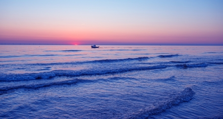Blue sunset at sea in summer photo