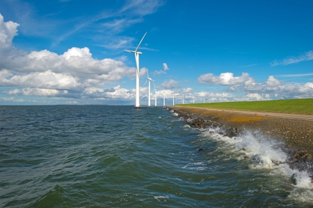Wind farm in a stormy lake photo