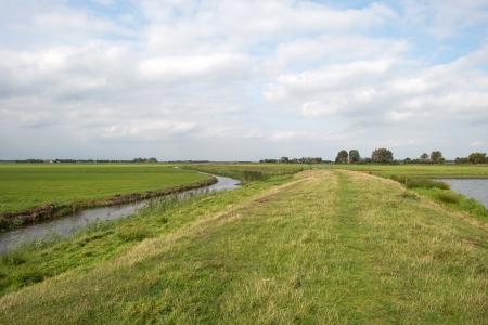 dike: Dike between canals in summer