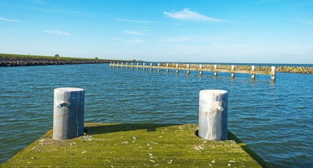 markermeer: Jetty in a lake in autumn Stock Photo