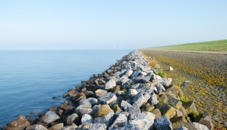 Dike along a lake at fall in mist Stock Photo - 15933945