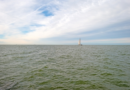 markermeer: Sailboat sailing on a lake at fall Stock Photo