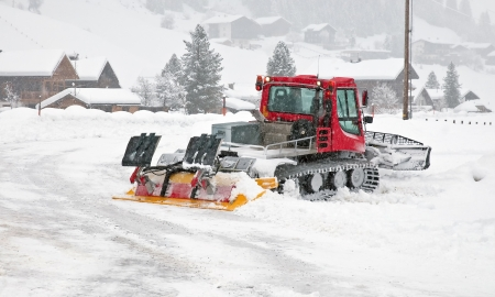 Snowplow at work in winter photo