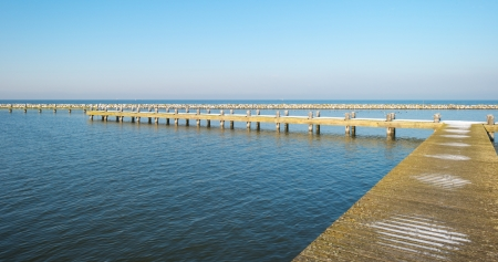 markermeer: Jetty covered in snow in winter Stock Photo