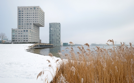 Highrise along a snowy lake in winter Stock Photo - 17376516