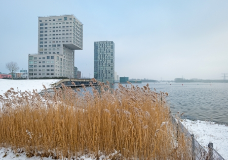 Highrise along a snowy lake in winter Stock Photo - 17376527