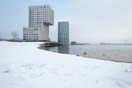 Highrise along a snowy lake in winter Stock Photo - 17376507