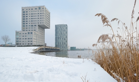 Highrise along a snowy lake in winter Stock Photo - 17376518
