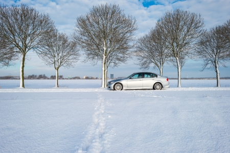 Car parked along a snowy road photo