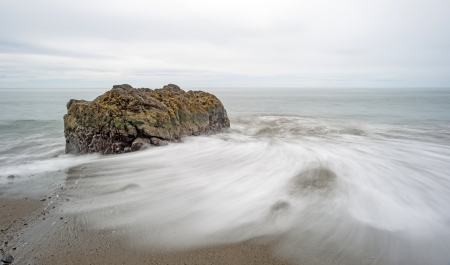 slow motion: Waves on a rocky beach in slow motion