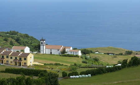Church along the coast of an island in the Atlantic Ocean photo