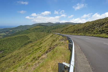Road through the hilly landscape of the Azores photo