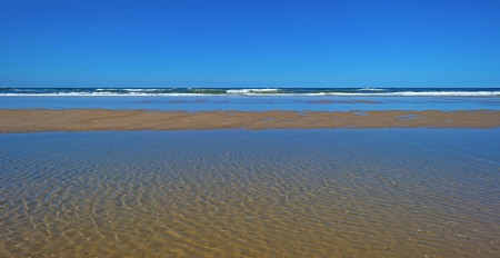 Beach and sea in summer under a blue sky photo