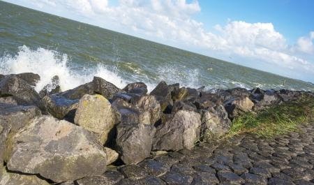 markermeer: Waves along a dike in a lake in summer
