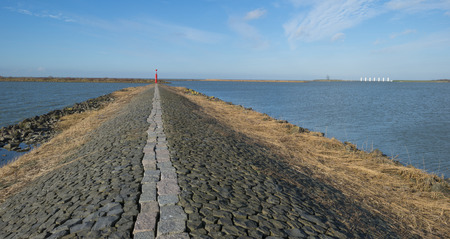 markermeer: The shores of a dike in a lake Stock Photo
