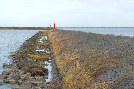 markermeer: Beacon on a dike in a lake Stock Photo