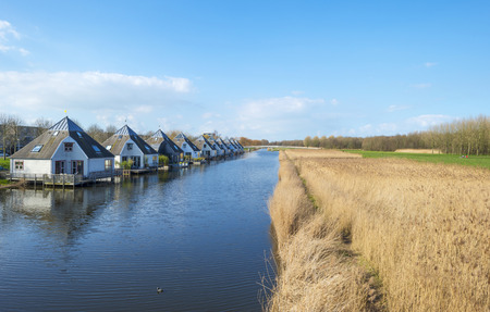 Houseboats in a sunny canal in winter photo