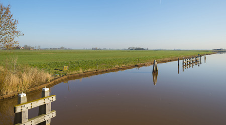 ���clear sky���: Bollards in a river under a clear sky