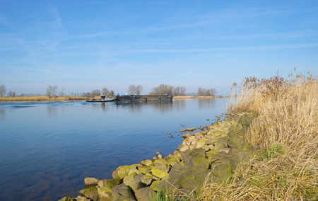 ���clear sky���: Barge sailing on a river under a clear sky