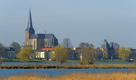 ijssel: Ancient Gothic church along a river