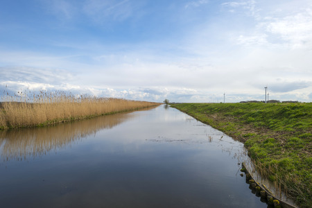 Canal through a rural landscape in spring photo
